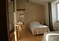 Chambre double traversante avec 2 lits simples