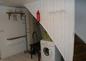 La buanderie avec lave-linge, aspirateur et table à repasser