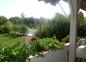 Terrasse vue sur parc et piscine
